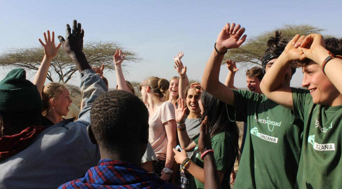 Projects Abroad volunteers in Tanzania are dancing with the local community they are working with.